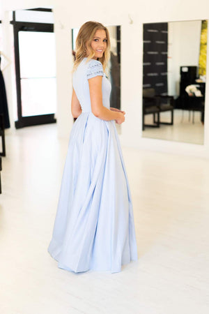 This Mac Duggal 25947 A-line gown in light blue features a modest cap sleeve with a high neckline and back.