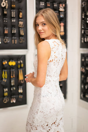 This SUG SD2013ST cocktail dress in white features lace appliqués, a V-neckline, and a high back.