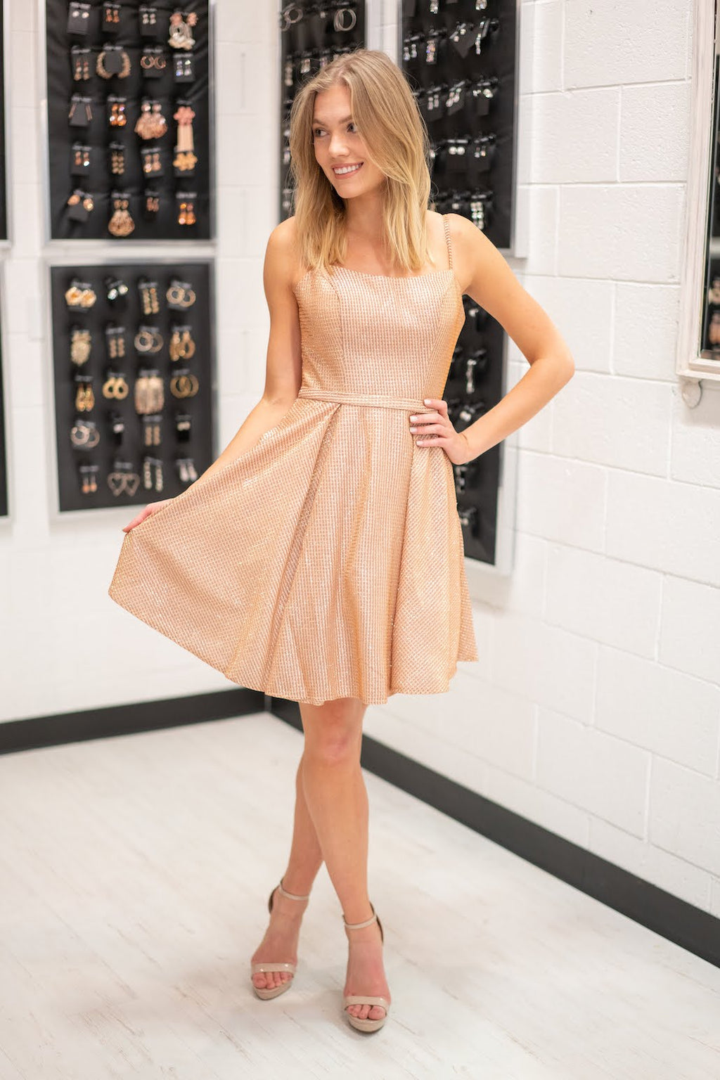 This LU 25655 rose gold flowy short dress has pockets and shimmer fabric.
