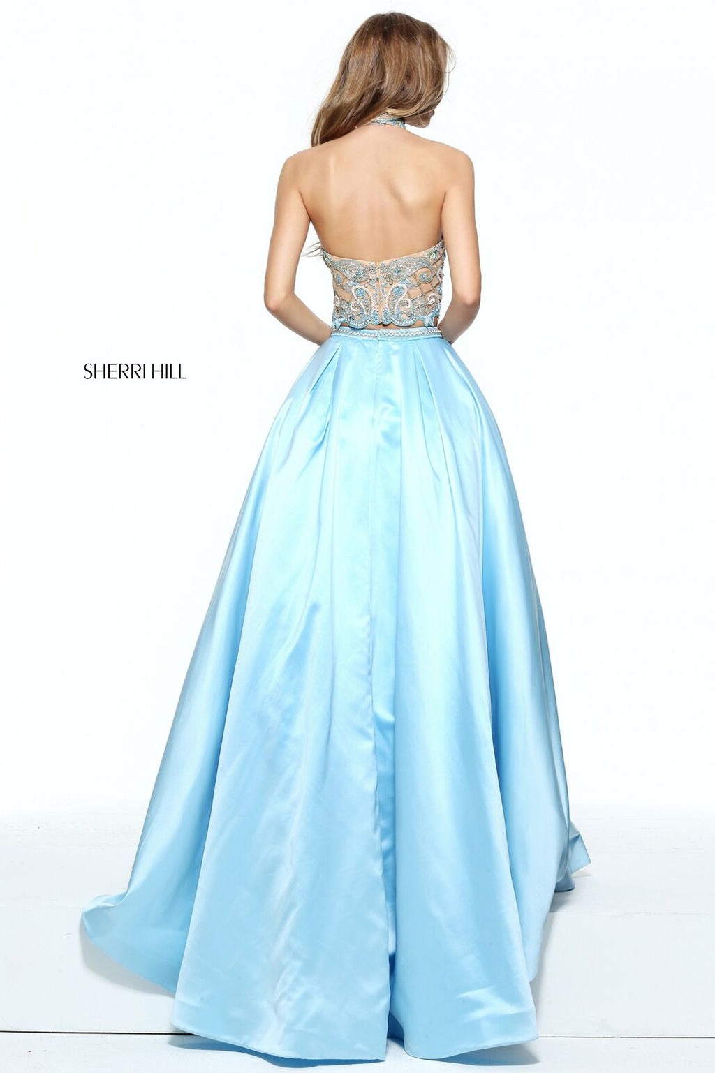 This Sherri Hill 51041 light blue two-piece ballgown has a halter and beaded bodice.