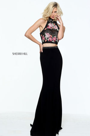 This Sherri Hill 51059 black fitted boho gown has a floral print bodice and fitted skirt.
