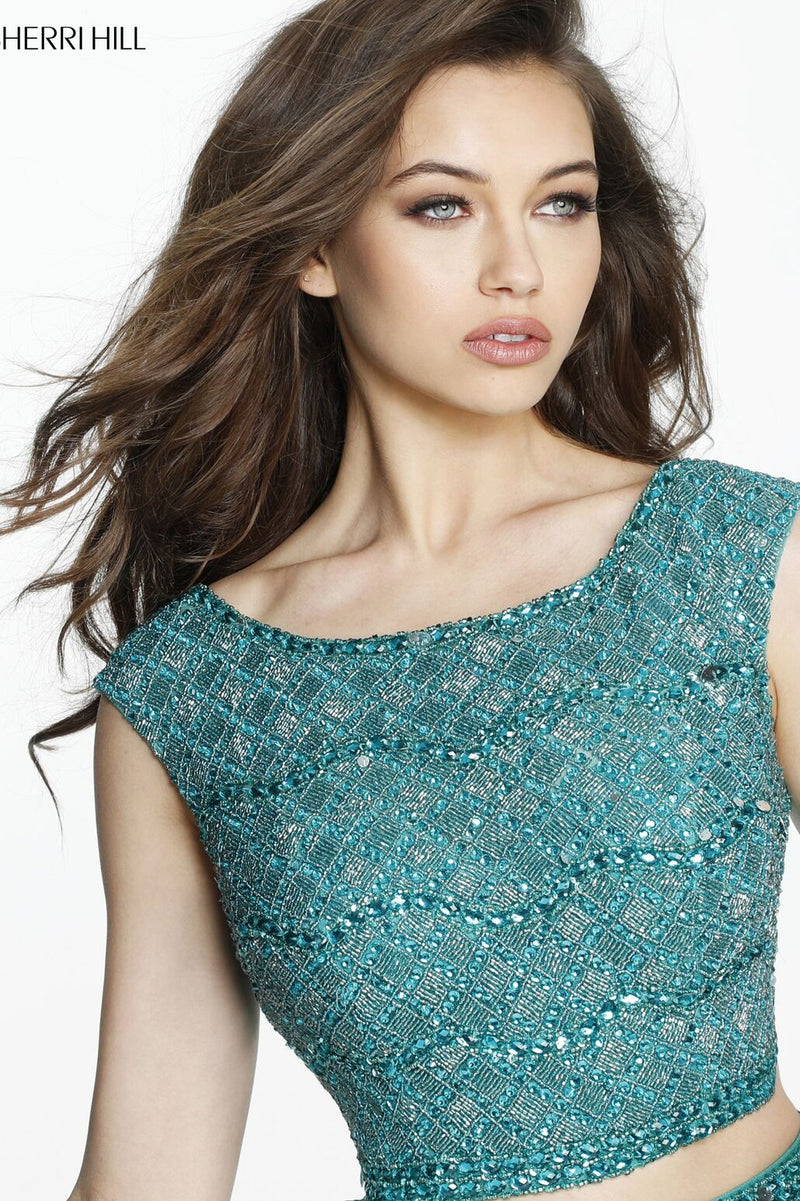 This Sherri Hill 51125 royal fitted two-piece gown has a beaded bodice and simple skirt.