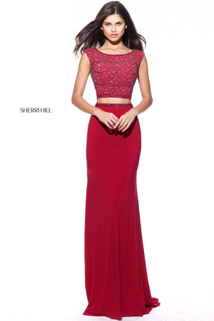 This Sherri Hill 51125 ruby fitted two-piece gown has a beaded bodice and simple skirt.