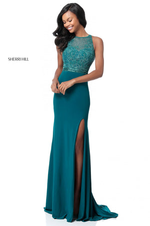 This Sherri Hill 51686 fitted gown in teal features a beaded high neck bodice and an open back.
