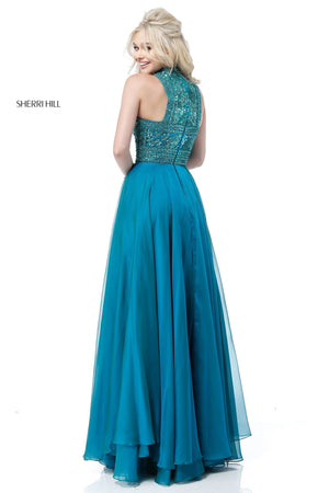 This Sherri Hill 51722 gown in jade features a beaded high neckline and a layered chiffon skirt.