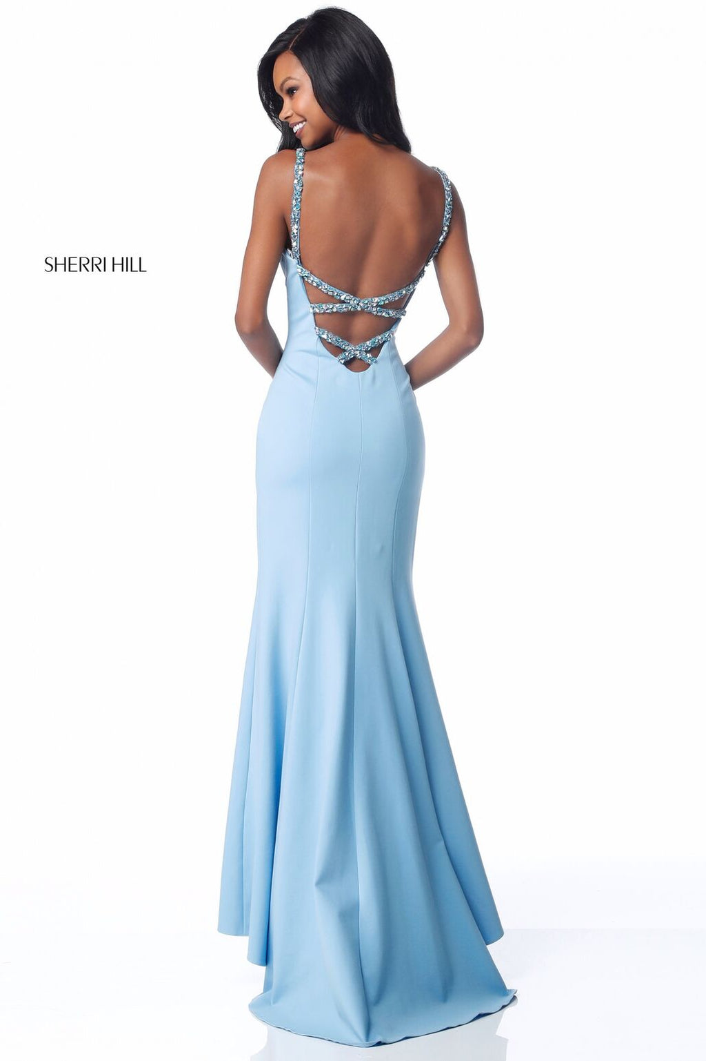 This Sherri Hill 51777 fitted jersey gown in light blue features bead encrusted straps and an open back.