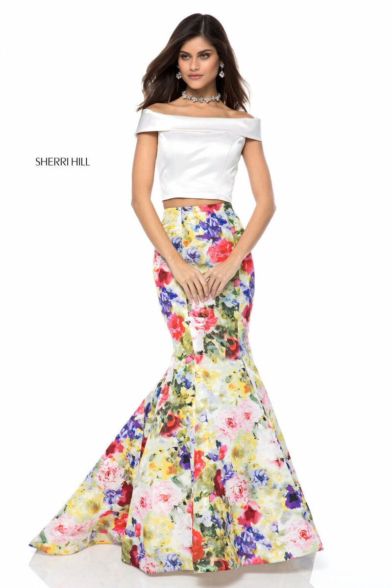 This Sherri Hill 52005 two piece mermaid gown with bold printed skirt is perfect for your next dance.