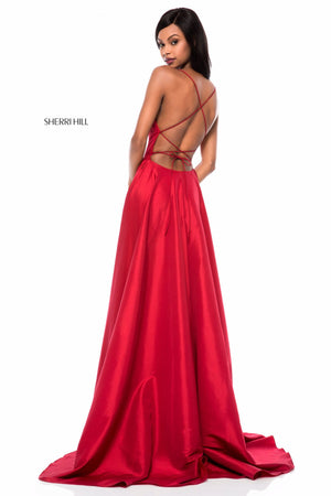 This Sherri Hill 52022 taffeta A-line gown in red features a lace-up back and a skirt slit.