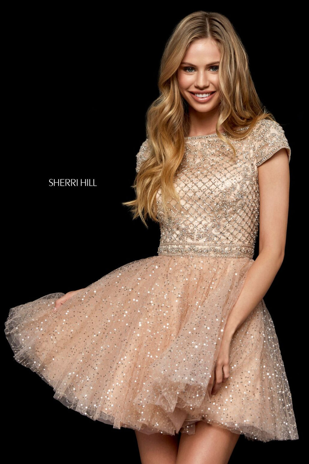 This Sherri Hill 52273 cocktail dress in nude/silver features a beaded bodice and a sequin tulle skirt.