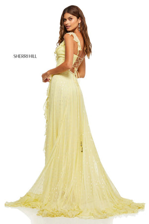 This Sherri Hill 52643 gown in yellow features a chiffon metallic print with ruffles on the hem and neckline.