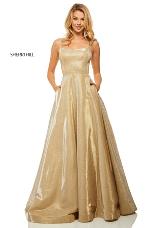 This Sherri Hill 52716 ballgown gown is a shimmery gold with a full skirt and a strappy open back.