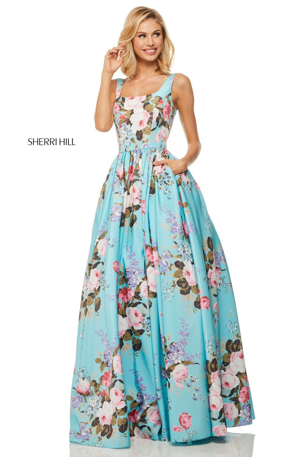 This Sherri Hill 52814 aqua A-line gown has a floral print and a tank bodice.