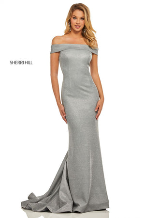 This Sherri Hill 52825 fitted electric silver gown features an off-the-shoulder neckline and a shimmer throughout the entire dress.