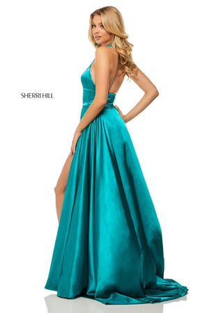 This Sherri Hill 52920 teal satin gown features a high-neck halter bodice and a side slit.