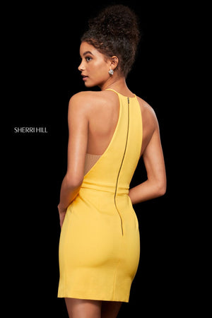 This Sherri Hill 53069 fitted cocktail dress in yellow features a halter neckline and a little side slit.