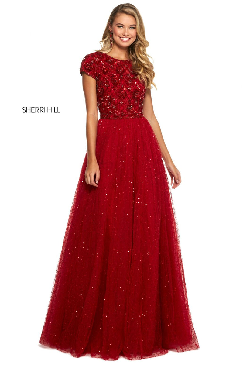 This Sherri Hill 53227 A-line gown in red features a high neck with a beaded bodice and an open back with a tulle shimmering skirt.