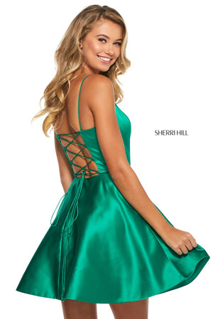 This Sherri Hill 53267 emerald cocktail dress is features pockets and a lace up back.