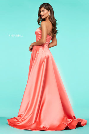 This Sherri Hill 53307 satin A-line gown features a strapless neckline and a skirt slit.