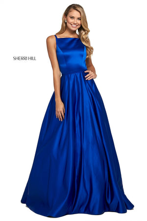 This Sherri Hill 53316 mikado A-line gown in royal features a bateau neckline, a cut out back, and embellished buttons.
