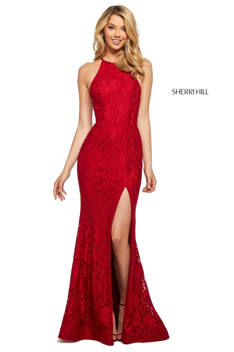 This Sherri Hill 53361 fitted stretch lace dress in dark red features a high cut halter style neckline and a skirt slit.
