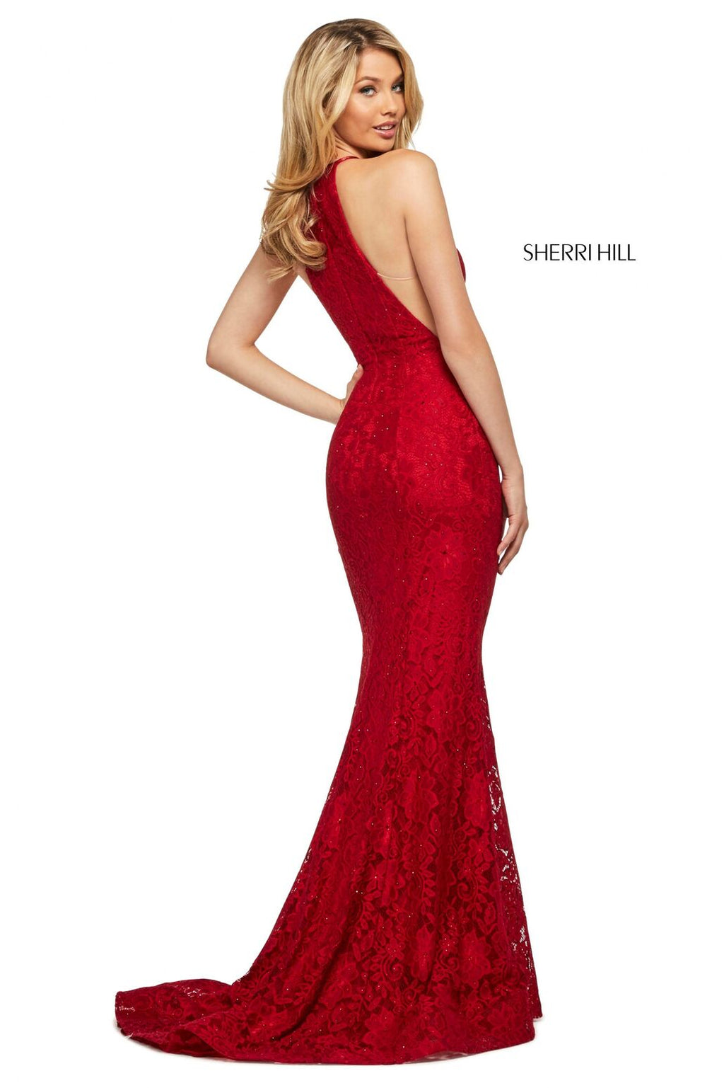 This Sherri Hill 53361 fitted stretch lace dress in red features a high cut halter style neckline and a skirt slit.