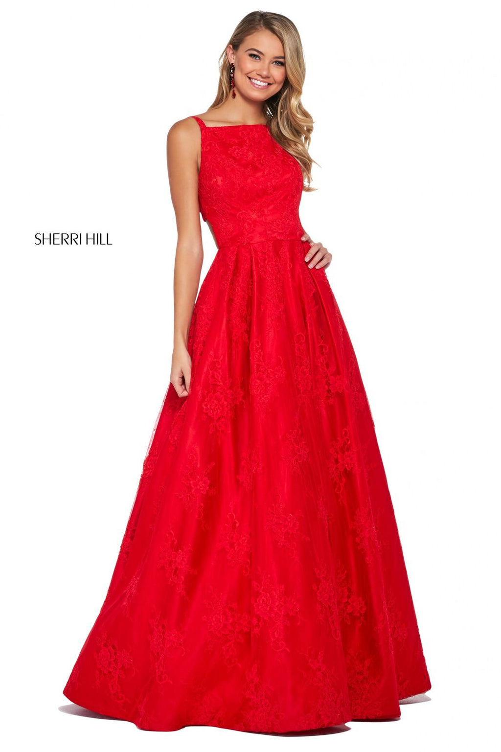 This Sherri Hill 53462 lace A-line dress in red features a bateau neckline and a cut out back with button details.
