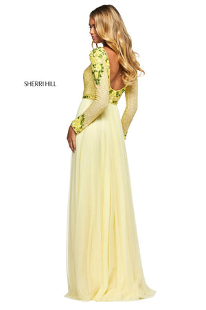 This Sherri Hill 53485 A-line gown in yellow features floral pattern sequins and a beaded bodice with long sleeves as well as a chiffon skirt.