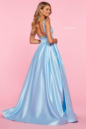 This Sherri Hill 53528 mikado A-line gown features unique beading on a straight neckline and straps.