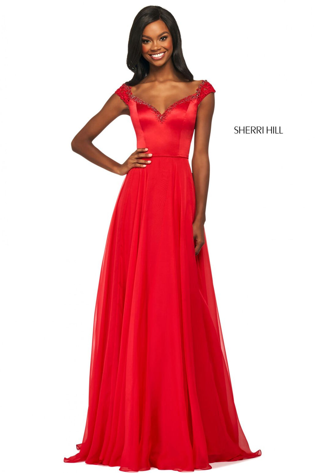 This Sherri Hill 53549 A-line gown in red features a satin bodice with a beaded sweetheart off-the-shoulder bodice, lace cap sleeves, and a chiffon skirt.