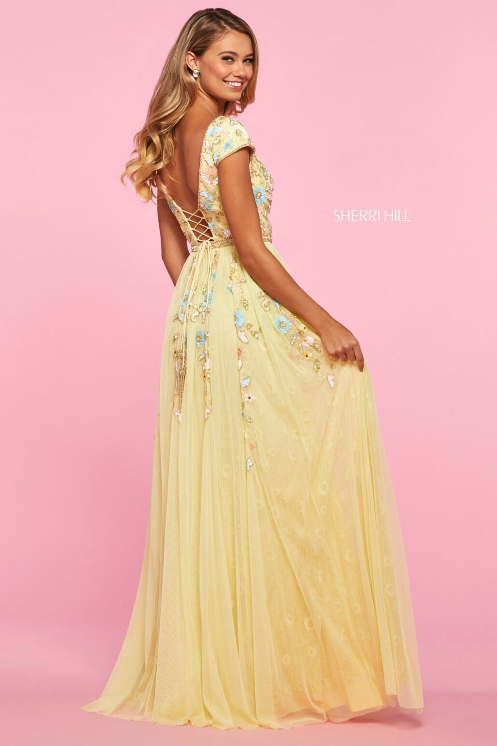 This Sherri Hill 53555 floral beaded A-line gown in yellow/multi features a cap sleeve bodice, a lace up back, and gathered chiffon with a lace skirt.