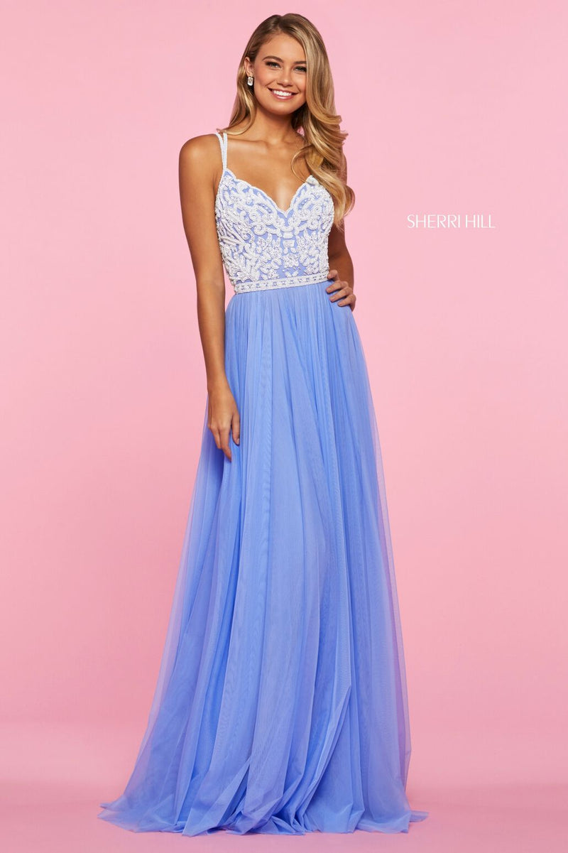 This Sherri Hill 53556 gown in periwinkle/ivory features a beaded bodice with a sweetheart neckline.