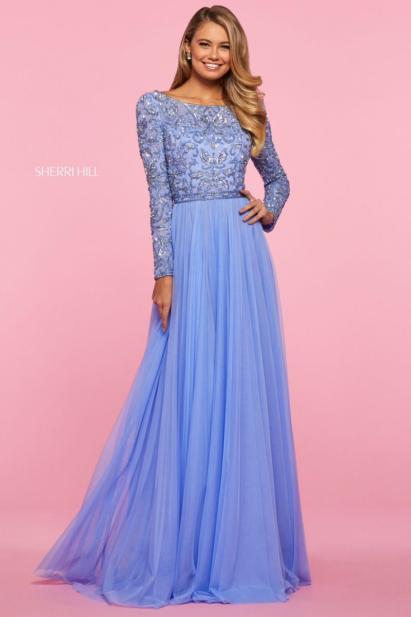 This Sherri Hill 53560 A-line gown in periwinkle features a long sleeve beaded bodice with a chiffon gathered skirt.