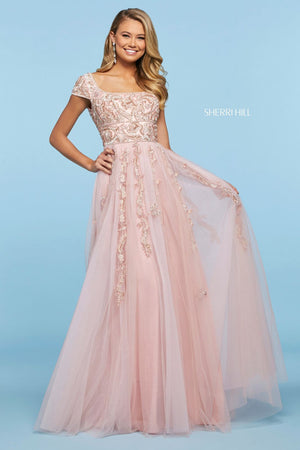 This Sherri Hill 53623 tulle A-line gown in blush features a beaded appliqué cap sleeve bodice with a straight neckline and an open back.