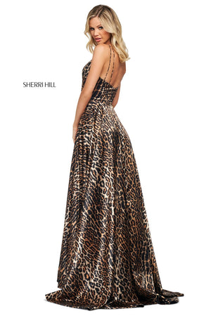 This Sherri Hill 53772 animal print satin A-line gown features a V neck wrap bodice and a skirt slit.