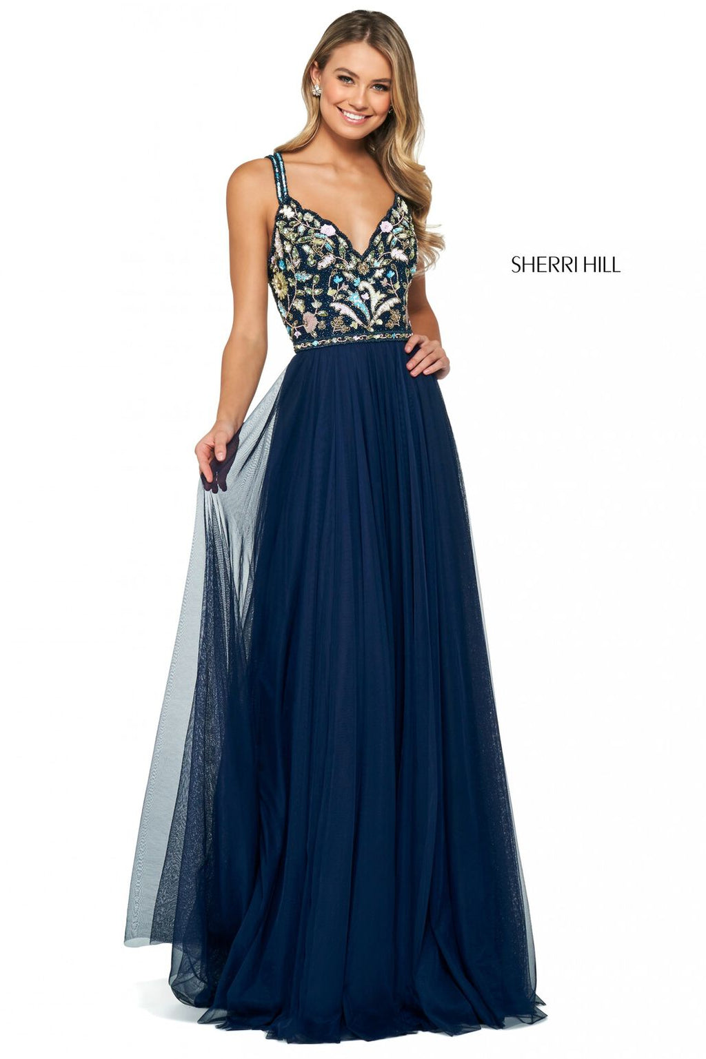 This Sherri Hill 53803 gown features a beaded bodice with a sweetheart neckline and a scrappy back with a chiffon skirt.