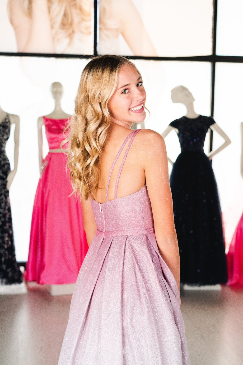 This DJ A9321 A-line shimmer ombre gown in pink features an open back and a sweetheart neckline.