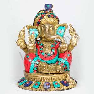 Brass Ganesha decorated with multicolored stones