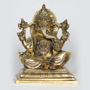 "Brass Ganesha Lord Ganapathi seated on brass pedestal 8"" Tall"