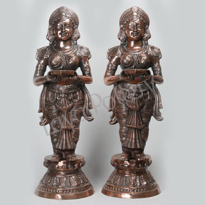 Black Metal Pava Villakku Statue Medium Pair