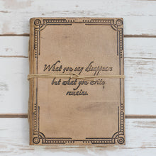 "Load image into Gallery viewer, ""What You Write"" Quote Embossed Tan Leather Journal - Glitzy Swan"