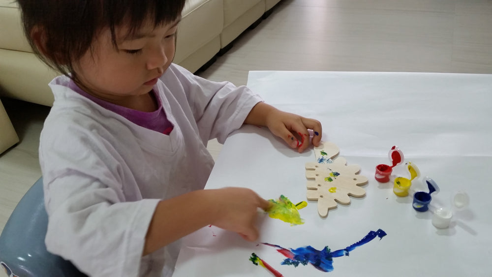 Girl playing craft
