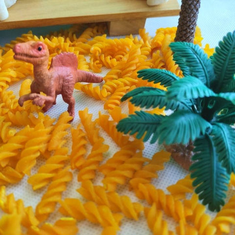 spinosaur toy figurine in sensory play