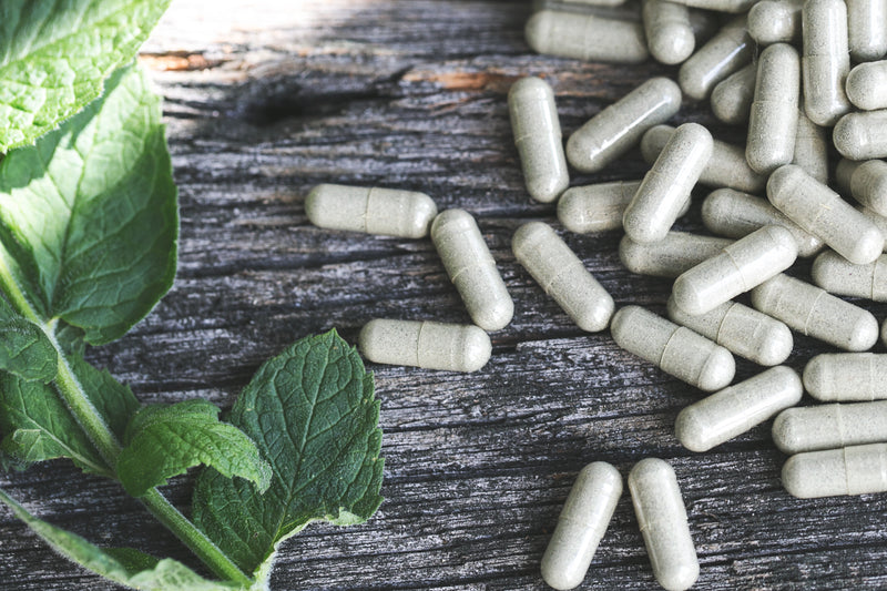 health supplements spilled with herbs