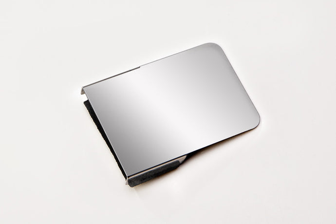 The stainless steel DaBlot Mini Cosmetic Palette was created for quick-draw touch ups and can be used on either hand or a countertop. It wraps around the fingers with an adjustable strap and rests on the back of the hand. You can even toss it in a set bag. Use in combination with the DaBlot Makeup Palette Sheets pad.