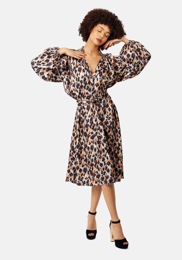 Traffic People V-Neck Silenced Midi Dress in Blue Leopard Print Close Up Image