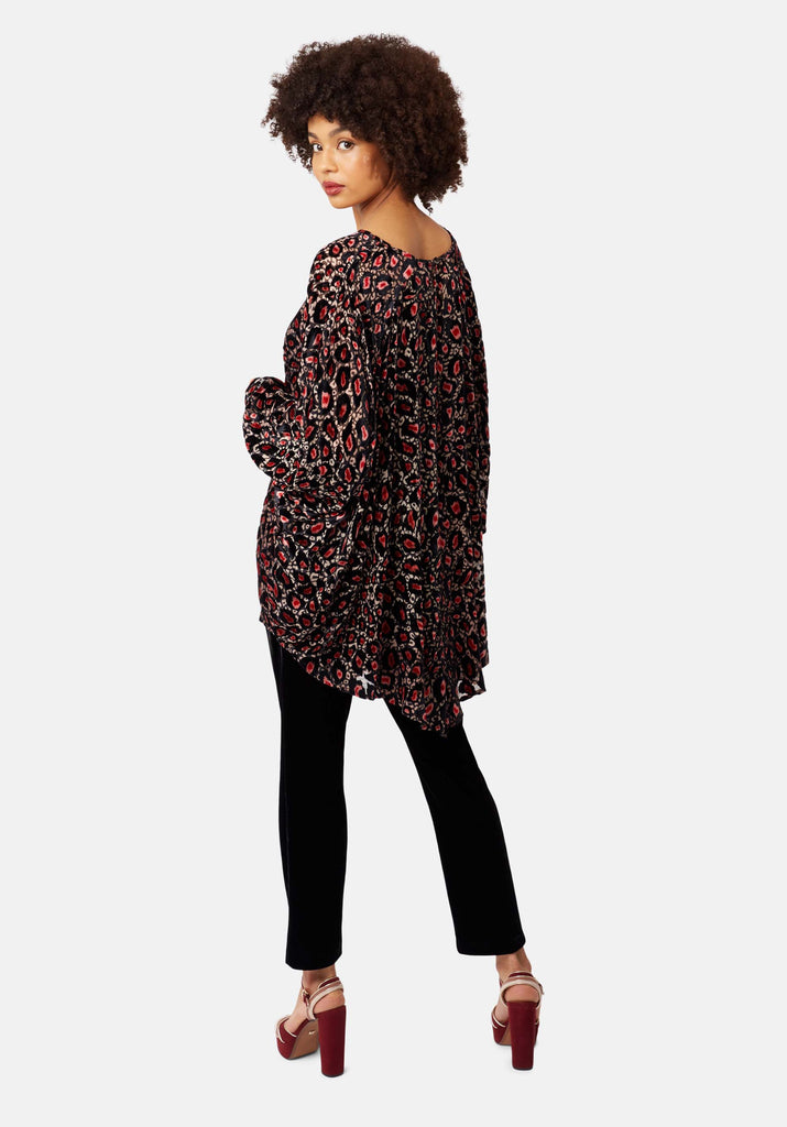 Traffic People Animal Print Batwing Asymmetric Top in Pink Back View Image