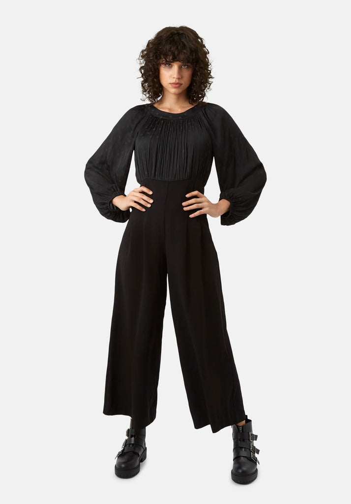 Traffic People Haughty Polka Dot Long Sleeved Jumpsuit in Black Front View Image