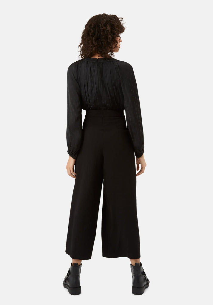 Traffic People Haughty Polka Dot Long Sleeved Jumpsuit in Black Side View Image