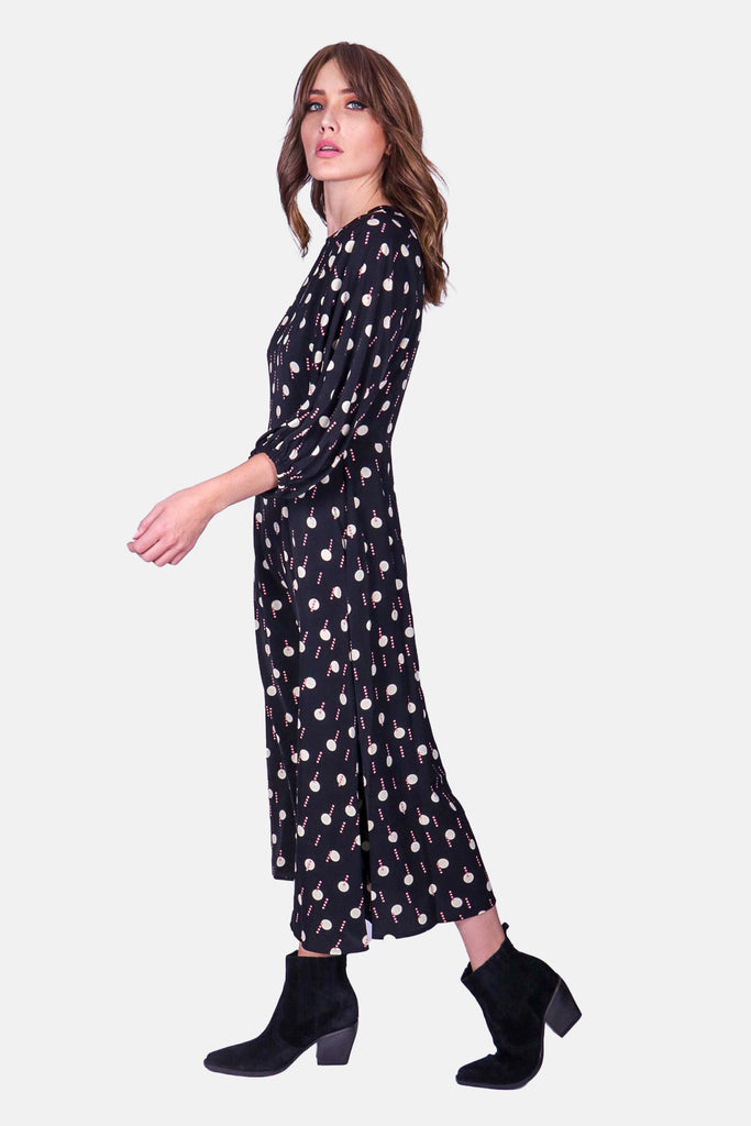 Traffic People Drape Printed Long Sleeve Midi Dress in Black and White Back View Image