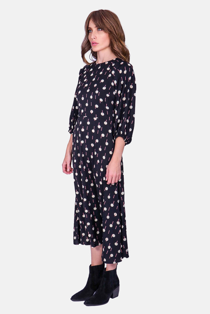 Traffic People Drape Printed Long Sleeve Midi Dress in Black and White Close Up Image